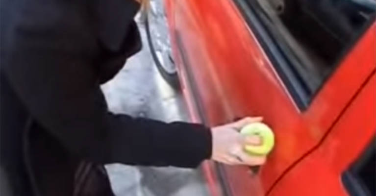 She Got Locked Out Of Her Car, So She Put A Tennis Ball Over The Keyhole - Featured